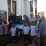 Members of the Community Outreach Committee with Fr Jim, Tracy and the kids